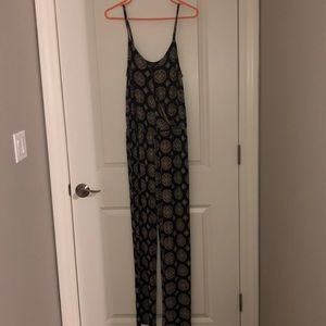 Brand new spaghetti strap jumpsuit w/pockets
